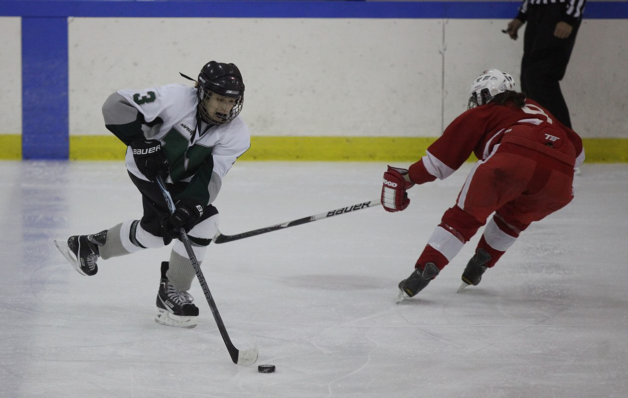 Olivia Zafuto, left, pictured during her Nichols School playing days in January 2012. (Buffalo News file photo)