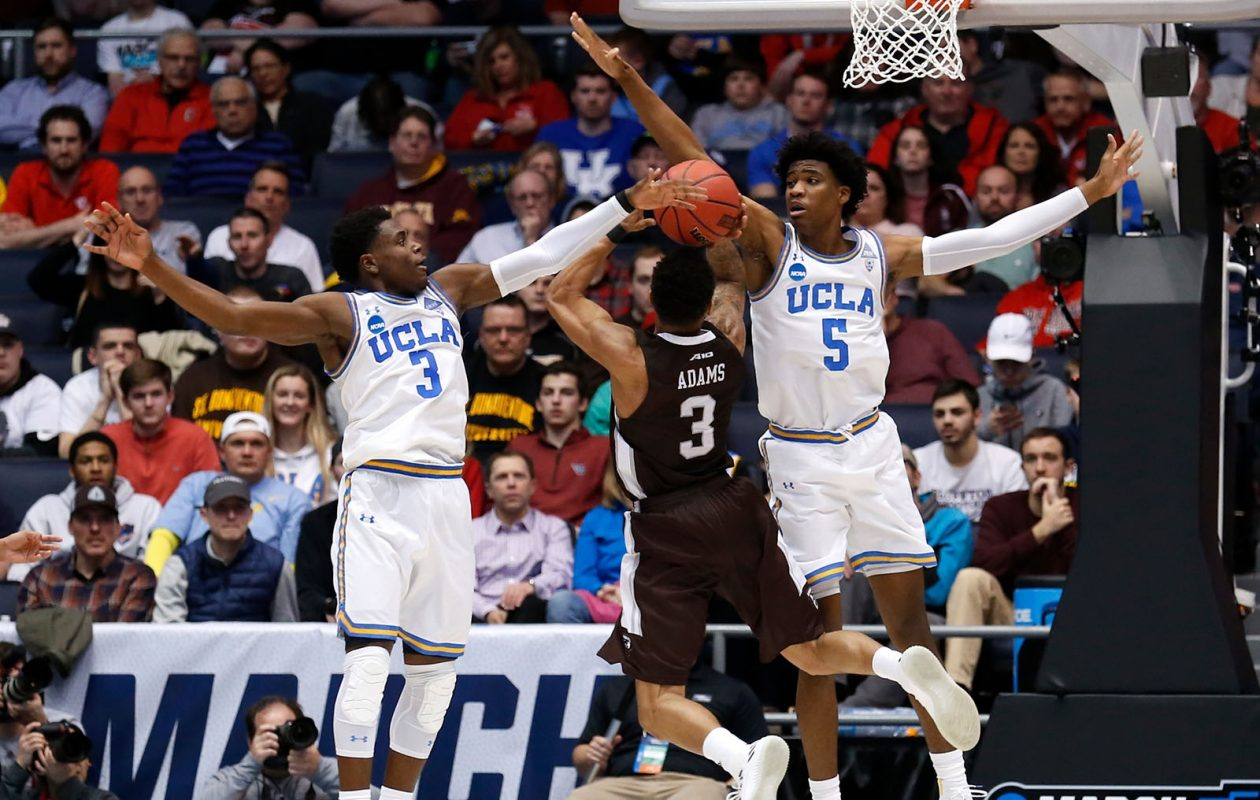 Jaylen Adams (3) of the St. Bonaventure Bonnies attempts a shot under pressure from Chris Smith (5) and Aaron Holiday (3) of the UCLA Bruins during the second half of the First Four game in the 2018 NCAA Men's Basketball Tournament at University of Dayton Arena on March 13, 2018, in Dayton, Ohio. (Kirk Irwin/Getty Images)