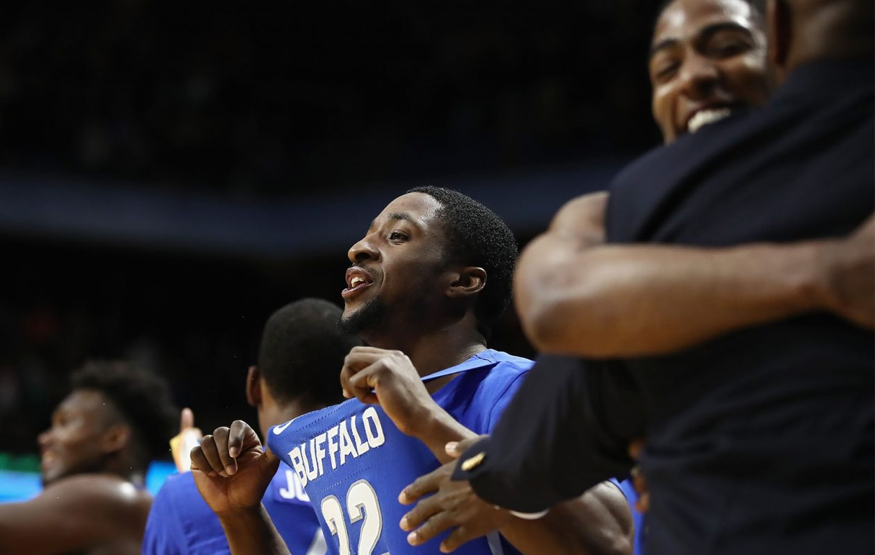 Defensive stalwart Dontay Caruthers (22) takes in the Bulls' upset win over Arizona.(Ezra Shaw/Getty Images)