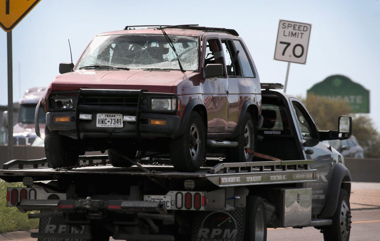 The vehicle that the Austin package bomber, Mark Anthony Conditt, was driving when he blew himself up is towed from the crime scene along Interstate 35 in suburban Austin on March 21, 2018 in Round Rock, Texas.  (Getty Images)