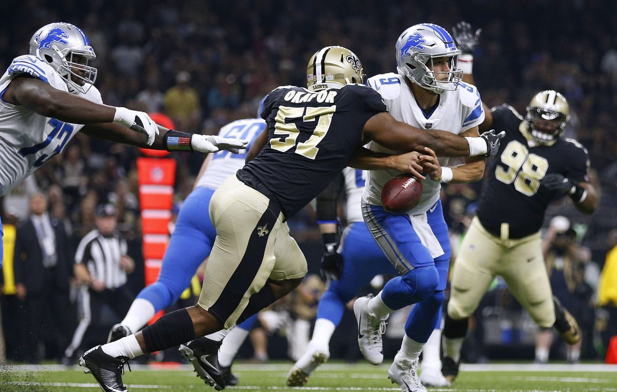 Alex Okafor of the New Orleans Saints forces a fumble on Matthew Stafford of the Detroit Lions. (Getty Images)