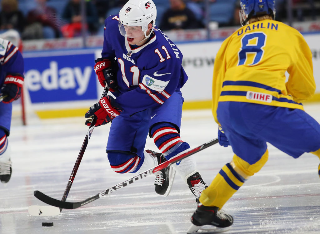 Casey Mittelstadt works the puck against presumtpive 2018 No. 1 draft pick Rasmus Dahlin during the USA-Sweden World Junior semifinal on Jan. 4 in KeyBank Center (Getty Images).