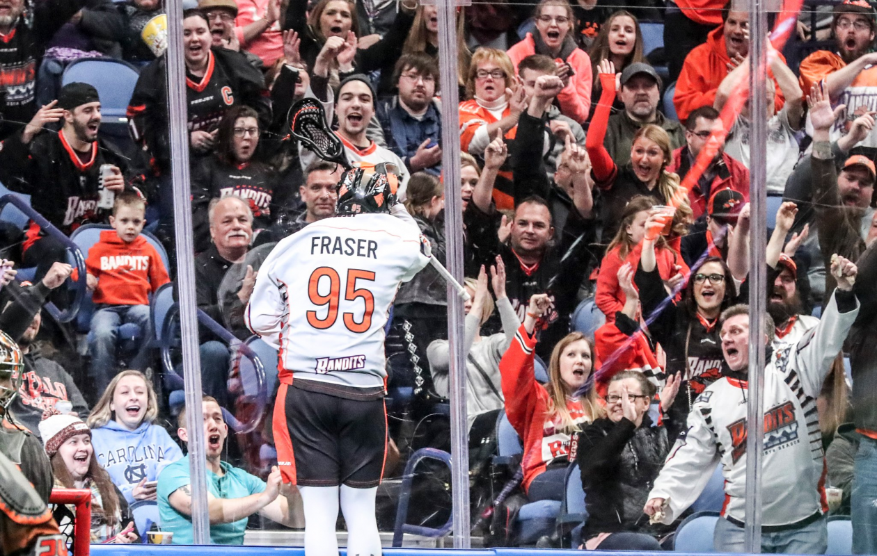 Bandits Chase Fraser jumps onto the glass after scoring a goal in the first quarter  at Key Bank Center in Buffalo N.Y. on Saturday, March 31, 2018.  (James P. McCoy/Buffalo News)