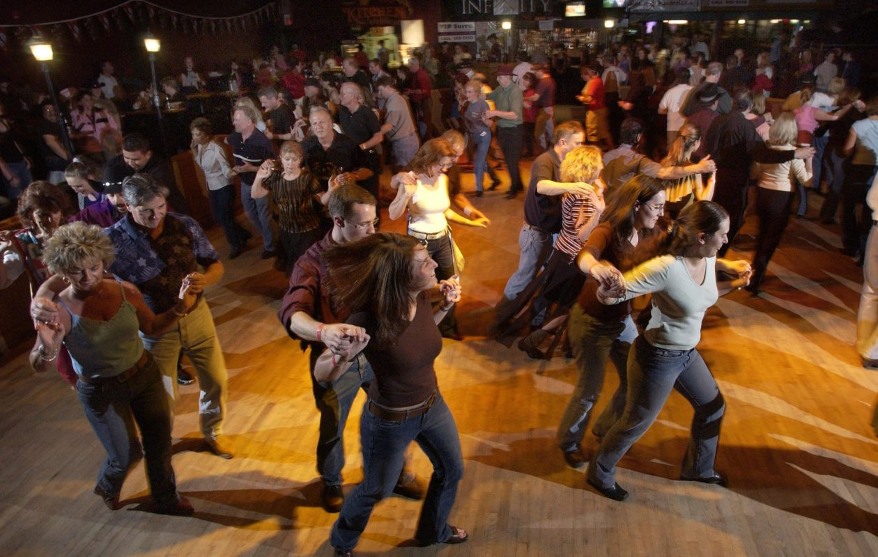 Country line-dancing lessons at Club Infinity in Clarence on March 31, 2005. The club,  which closed in 2013,  owes the state $873,000 in unpaid taxes,  interest and penalties.  (Buffalo News file photo)