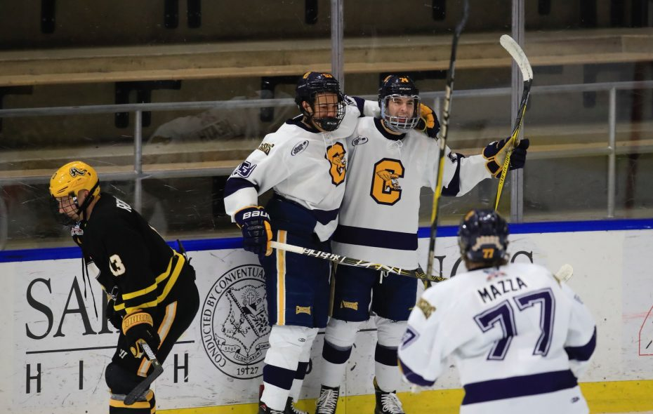 Canisius hockey players Cameron Heath, Felix Chamberland and Jimmy Mazzo celebrate a first-period goal on March 9, 2018 (Harry Scull Jr/Buffalo News)