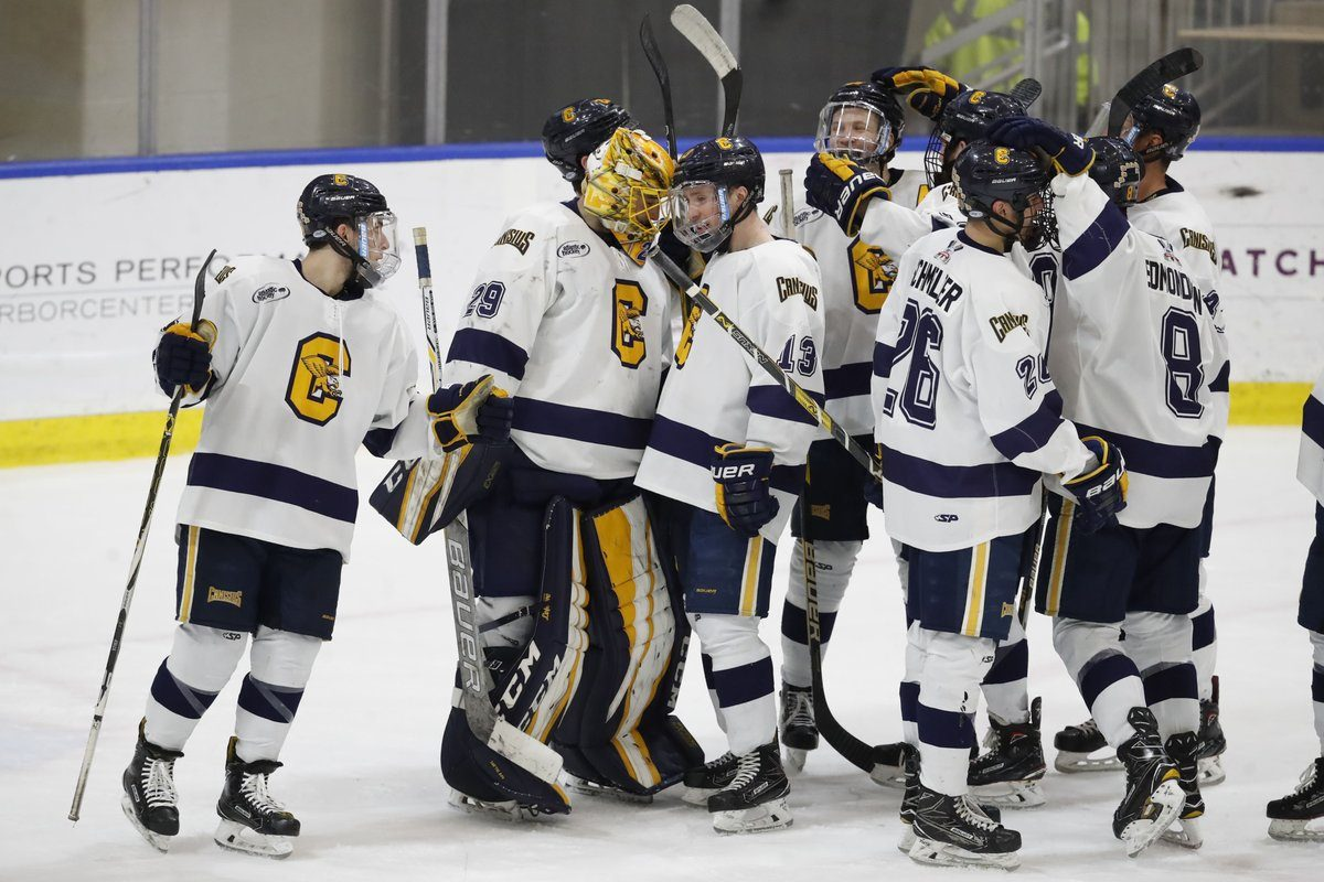 Canisius' Dylan McLaughlin (13) congratulates goalie Daniel Urbani after their playoff win (Harry Scull Jr./Buffalo News)