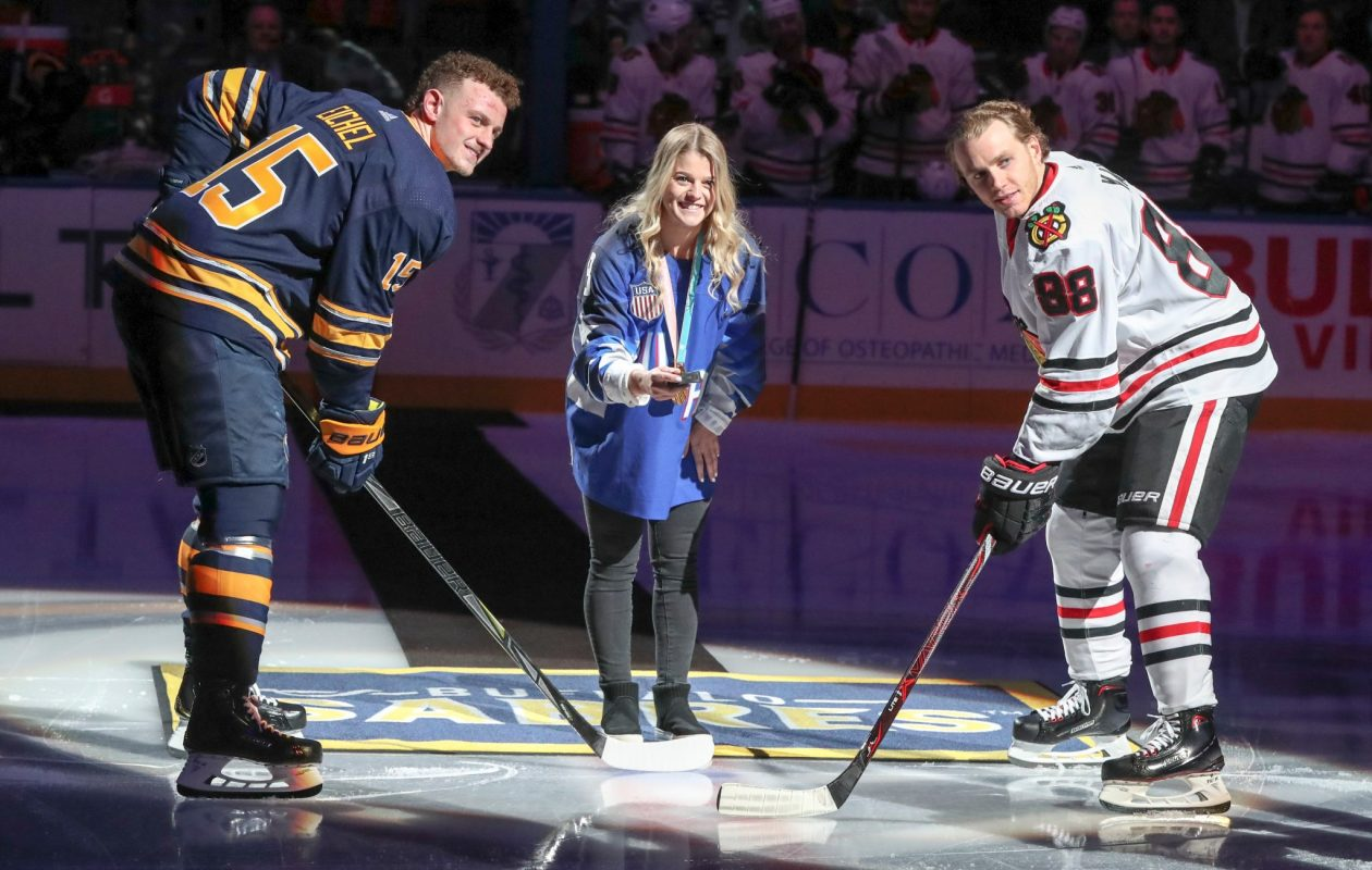 It was a USA Hockey get-together as Olympian Emily Pfalzer dropped the ceremonial faceoff for the Sabres' Jack Eichel and Chicago's Patrick Kane. (James P. McCoy/Buffalo News)