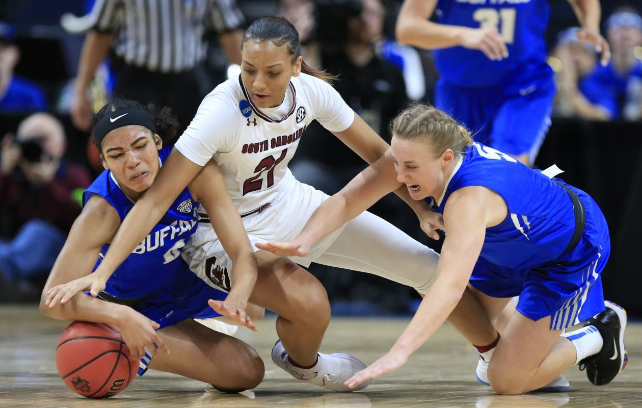 Summer Hemphill, left, and Katherine Ups battle for a loose ball with Mikah Herbert Harrigan. (Harry Scull Jr./Buffalo News)