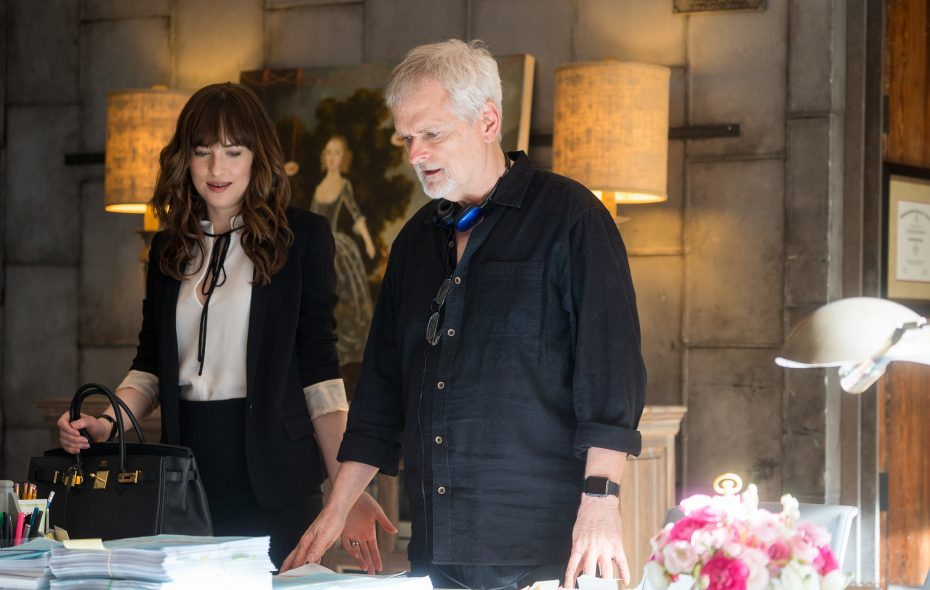 """Director James Foley, a University at Buffalo graduate, with actress Dakota Johnson on the set of """"Fifty Shades Freed."""" (Courtesy Universal Pictures)"""