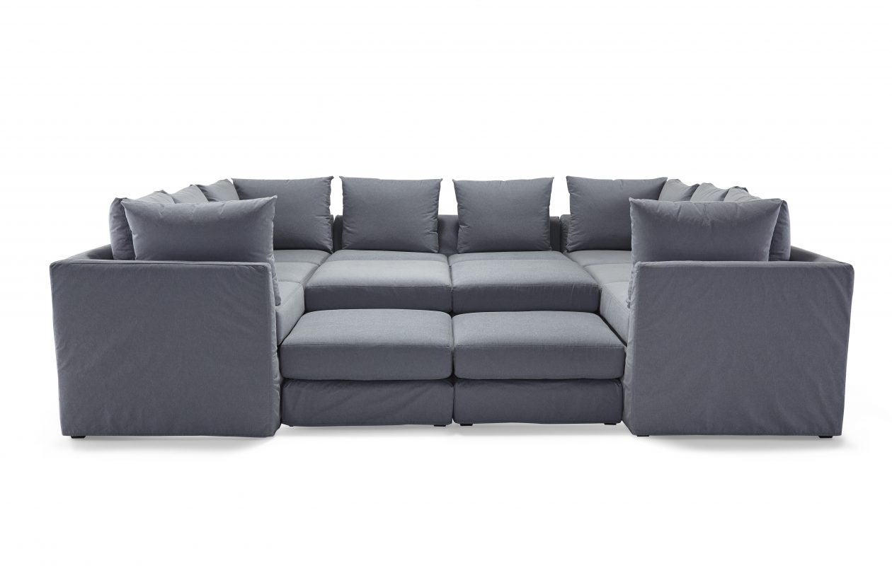 """Meet Dr. Pitt, a seven-piece sectional from the Mitchell Gold + Bob Williams collection. The company website  describes it as a 'modern interpretation of a disco-era classic."""" It's shown in chambray denim."""