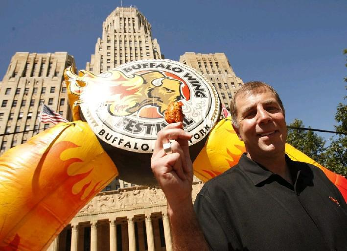 'Wing King' Drew Cerza holds up a 'jumbo' chicken wing at a news conference promoting the 2012 National Buffalo Wing Festival. Cerza is now starting a National Blue Cheese Dressing Day on July 16. {Derek Gee /Buffalo News file photo}