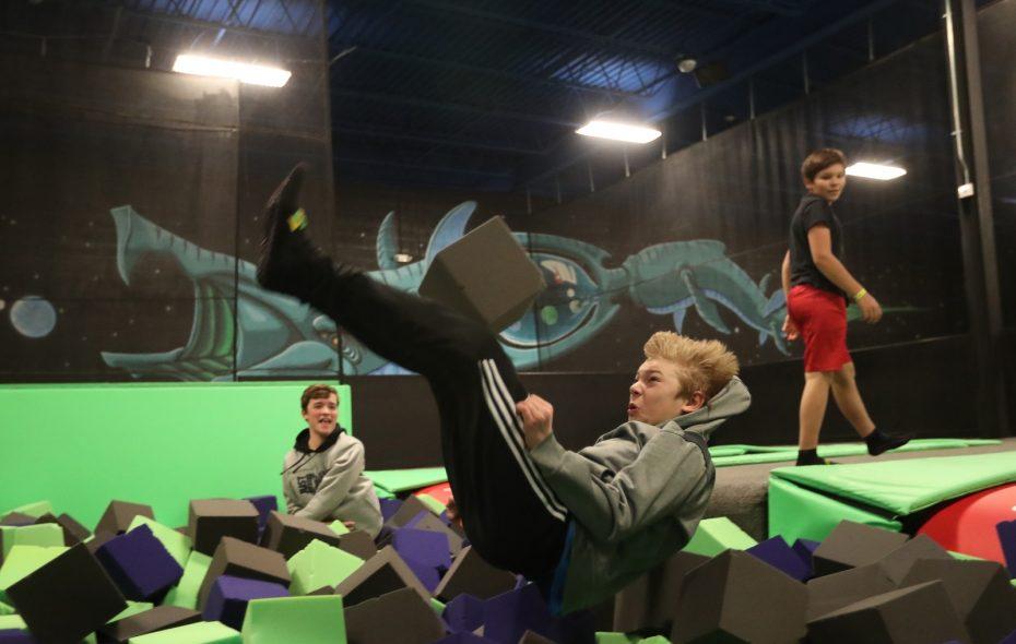 Ryan Herzog, 12, lands after a flip off the trampoline at Get Air trampoline park. (Sharon Cantillon/Buffalo News)