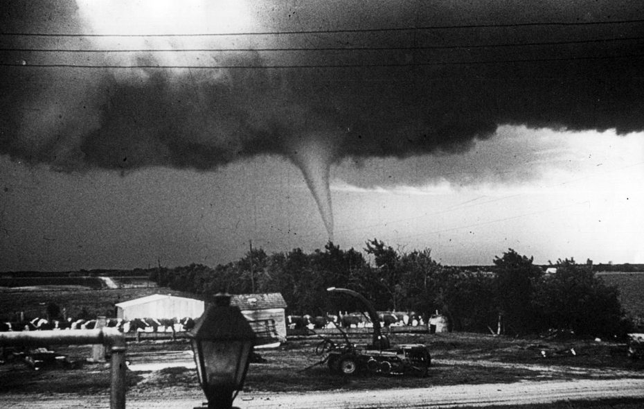 The distinctive funnel cloud of a  tornado touches ground near Lyons, Ka., on May 26, 1959. (Bert Hoyt/Three Lions/Getty Images file photo)