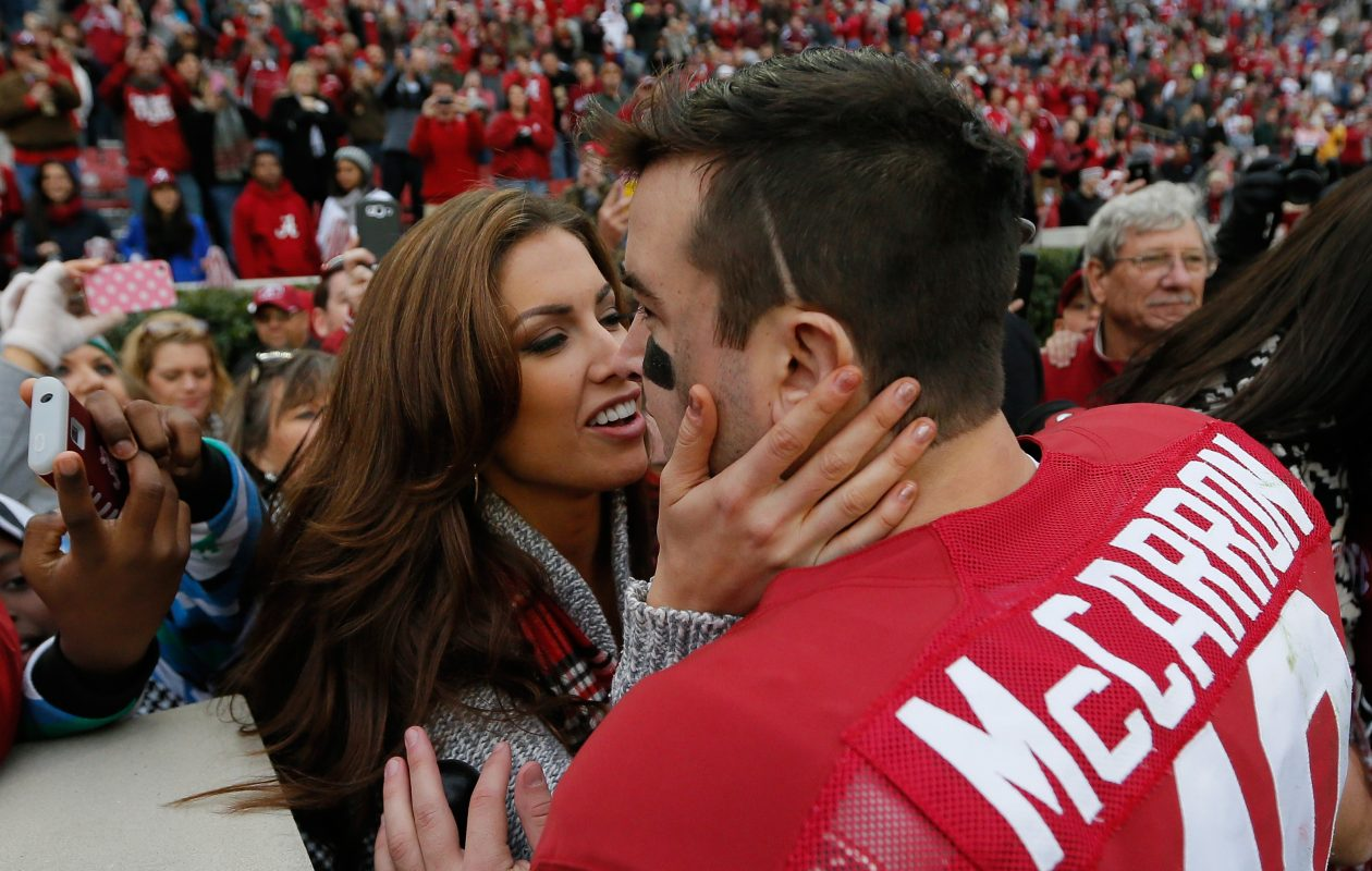 AJ McCarron of Alabama celebrates a 49-0 win over Chattanooga with his girlfriend Katherine Webb at Bryant-Denny Stadium on November 23, 2013.  (Photo by Kevin C. Cox/Getty Images)