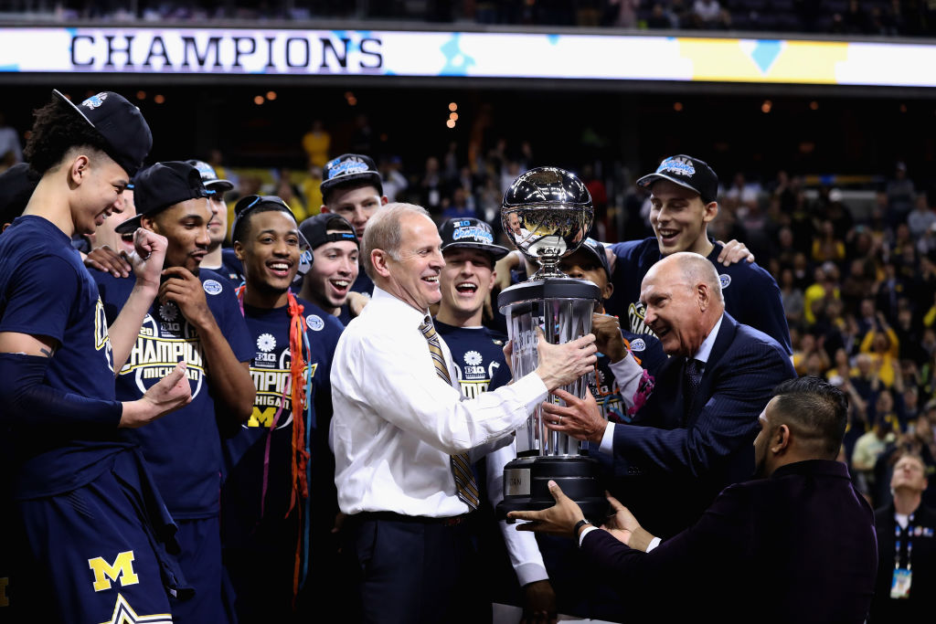 Jerry Sullivan has picked John Beilein and the Michigan Wolverines to win the NCAA trophy this season; the team is pictured being presented the 2017 Big Ten championship.  (Getty Images)