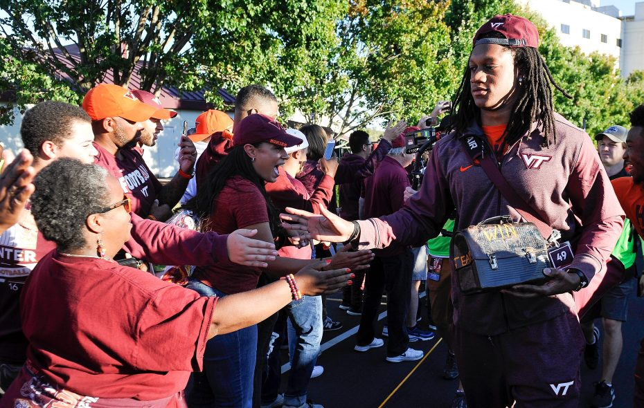 Tremaine Edmunds of Virginia Tech Hokies greets fans as he enters Lane Stadium (Michael Shroyer/Getty Images)