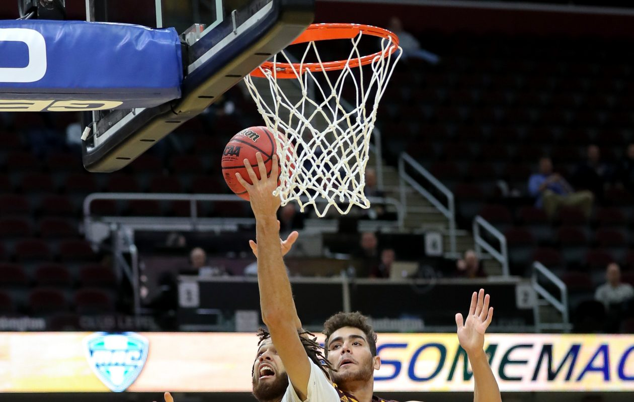 Buffalo Bulls forward Jeremy Harris drives to the basket past Central Michigan guard Kevin McKay during the second half of the MAC Men's Basketball Tournament Quarterfinal game Thursday. (Getty Images)