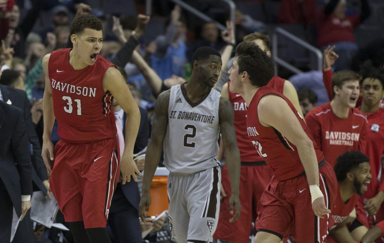 Kellan Grady (31) of the Davidson Wildcats reacts after making a basket in front of Matt Mobley of  the Bonnies. (Getty Images)