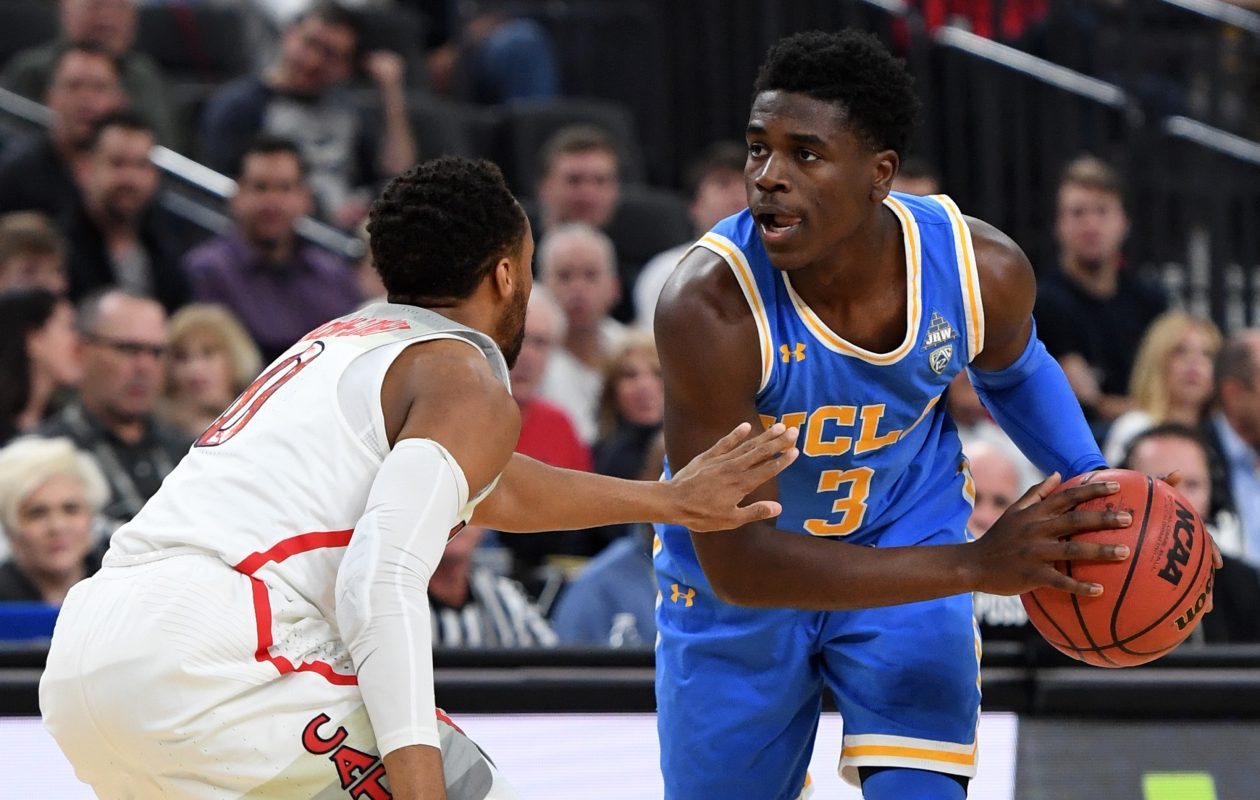 Aaron Holiday of the UCLA Bruins is guarded by Parker Jackson-Cartwright of the Arizona Wildcats during a semifinal game of the Pac-12 on March 9, 2018. (Getty Images)