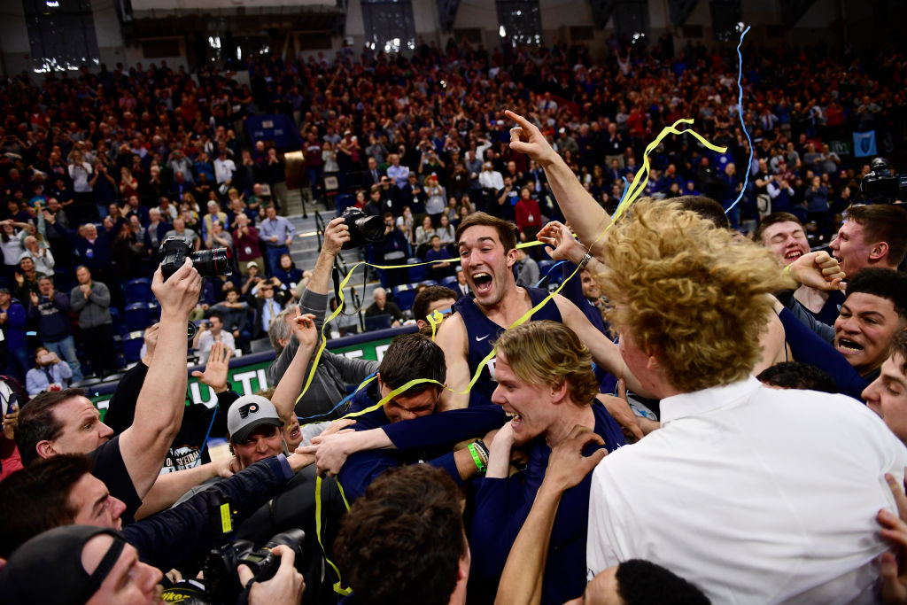 Matt MacDonald (20) of the University of Pennsylvania celebrates the Quakers' Ivy League Championship at The Palestra on March 11, 2018 in Philadelphia. (Getty Images)