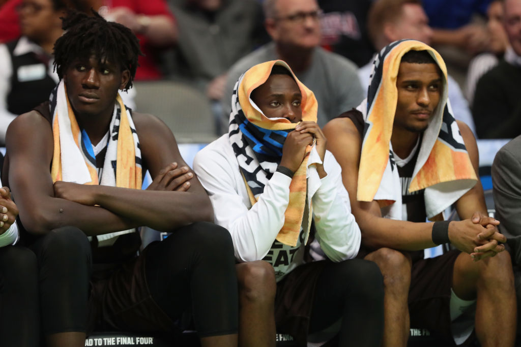 From left: Amadi Ikpeze, Nelson Kaputo and Idris Taqqee  face the harsh reality of Bona's NCAA loss to Florida in Dallas Thursday night. (Getty Images)