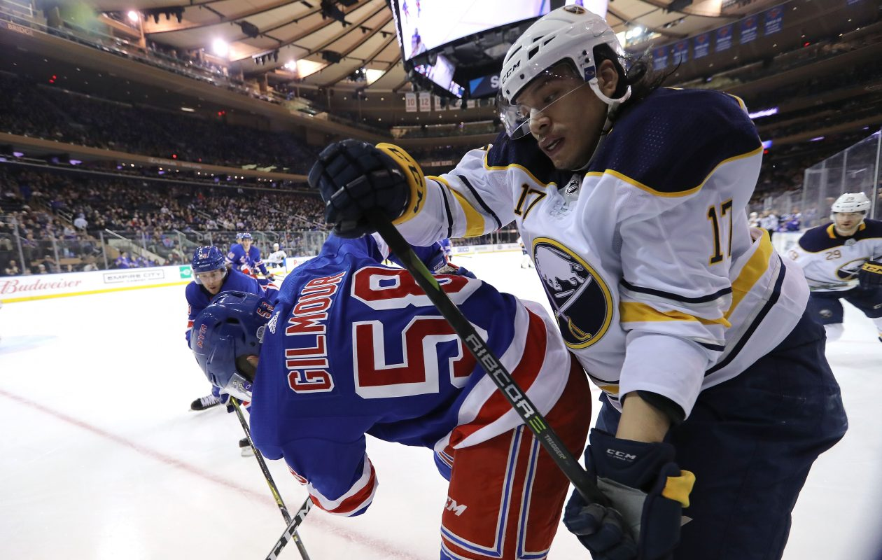 Jordan Nolan, battling the Rangers' John Gilmour on Saturday, is one of the few Sabres with experience winning. But he's a role player who can't put the team on his back. (Getty Images)