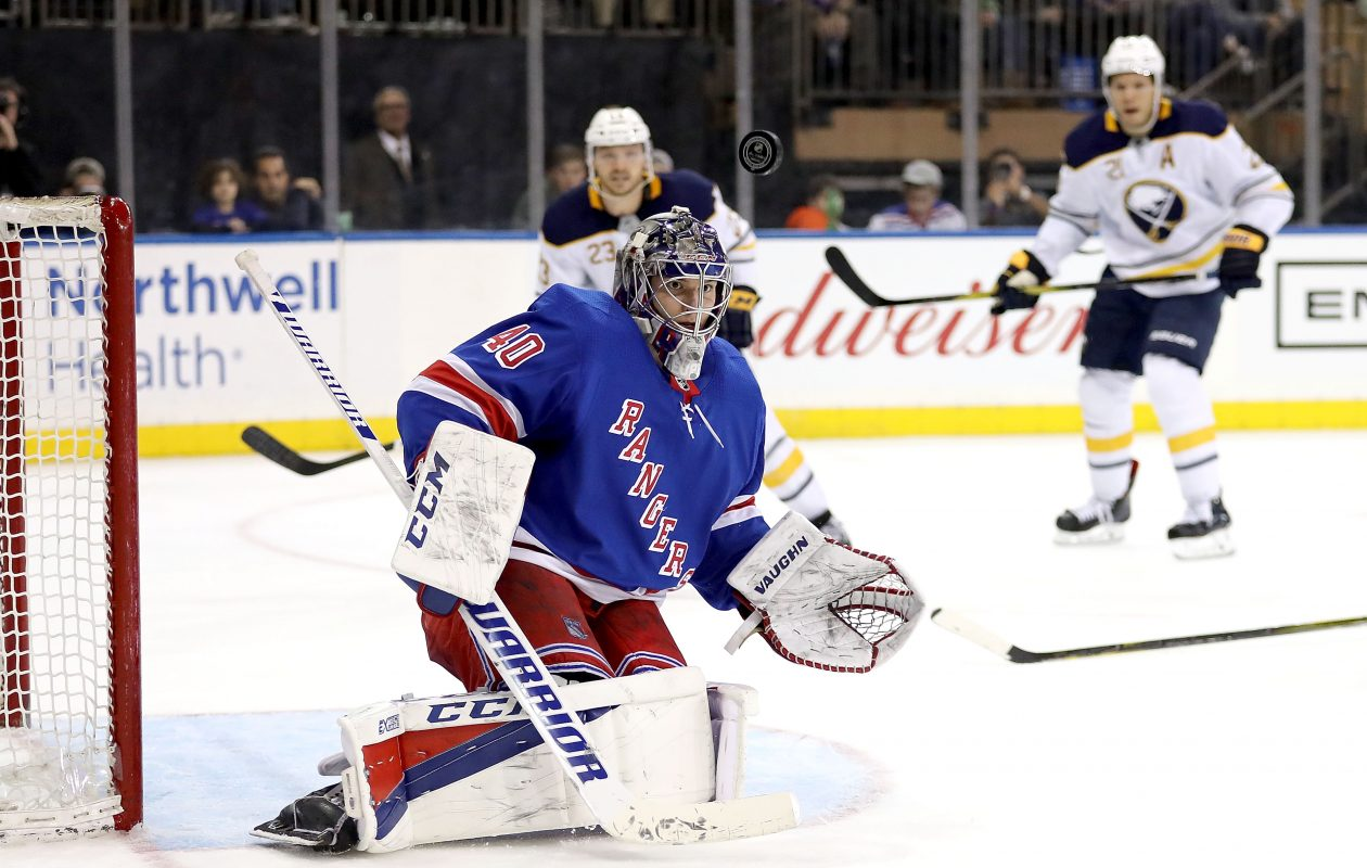 Rangers goalie Alexandar Georgiev turned aside 43 of 44 shots. He stopped this one but was beaten by the Sabres' Sam Reinhart (23) on a late power play. (Getty Images)