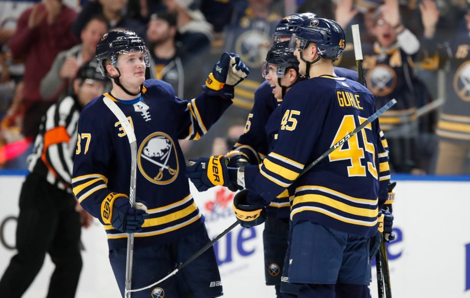 The Sabres' Casey Mittelstadt (37) joins smiling Evan Rodrigues and Brendan Guhle after recording an assist for his first NHL point Thursday. (Harry Scull Jr./Buffalo News)
