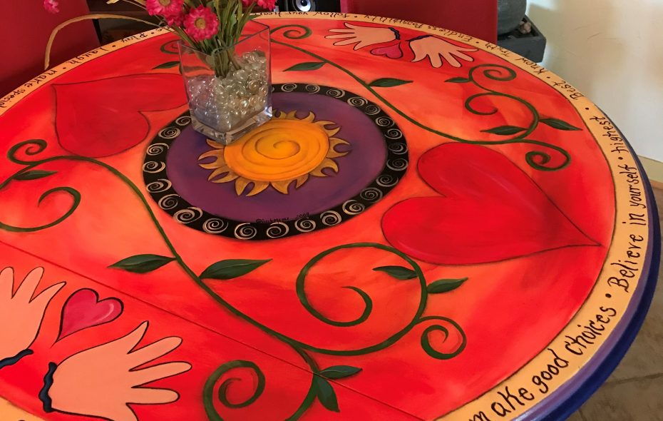 A handpainted kitchen table is engraved with motivational words. (Photo courtesy Jean Marie)