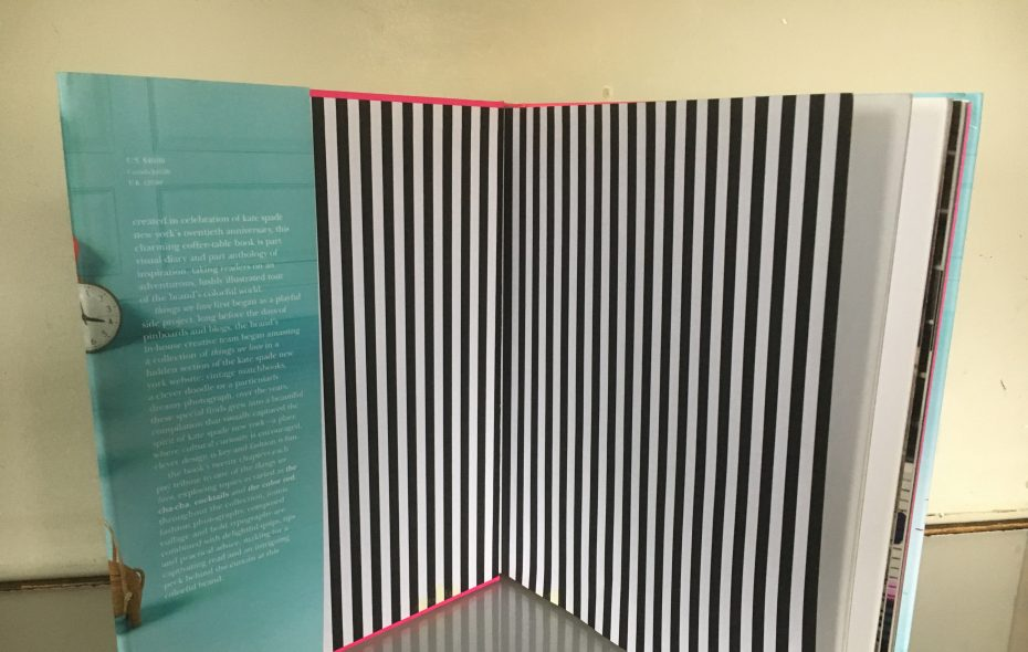 """Stripes show up in some unexpected places, such as inside book covers. Shown here: a peek  inside """"Kate Spade New York: Things we Love."""" (Abrams)"""