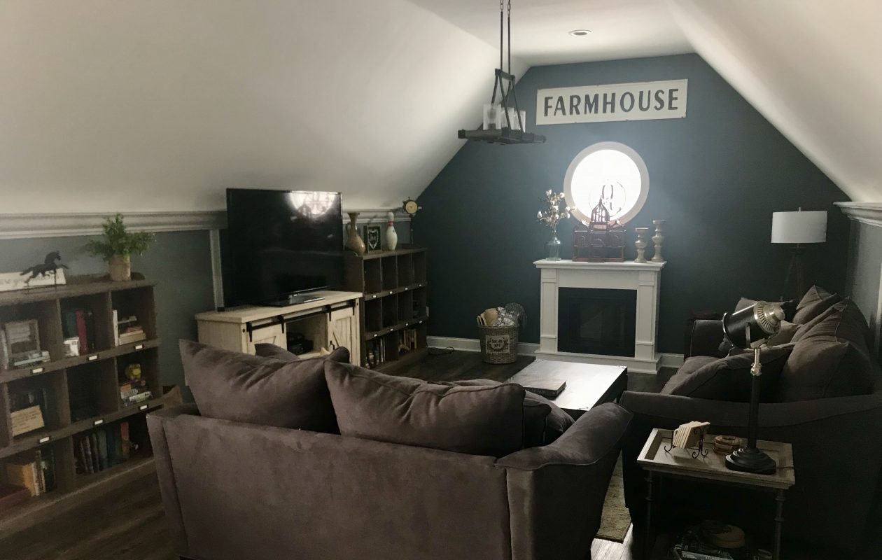The bonus room above the garage is a favorite place to relax. (via Molly Dohm)