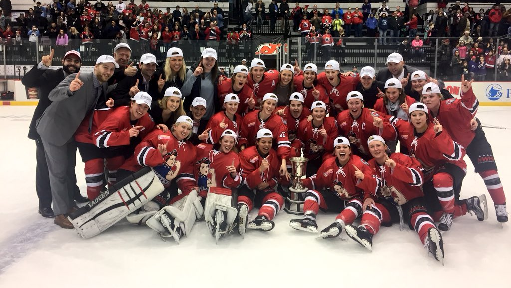 The Metropolitan Riveters celebrate with the Isobel Cup after a 1-0 victory against the Buffalo Beauts. (Photo courtesy of the NWHL)