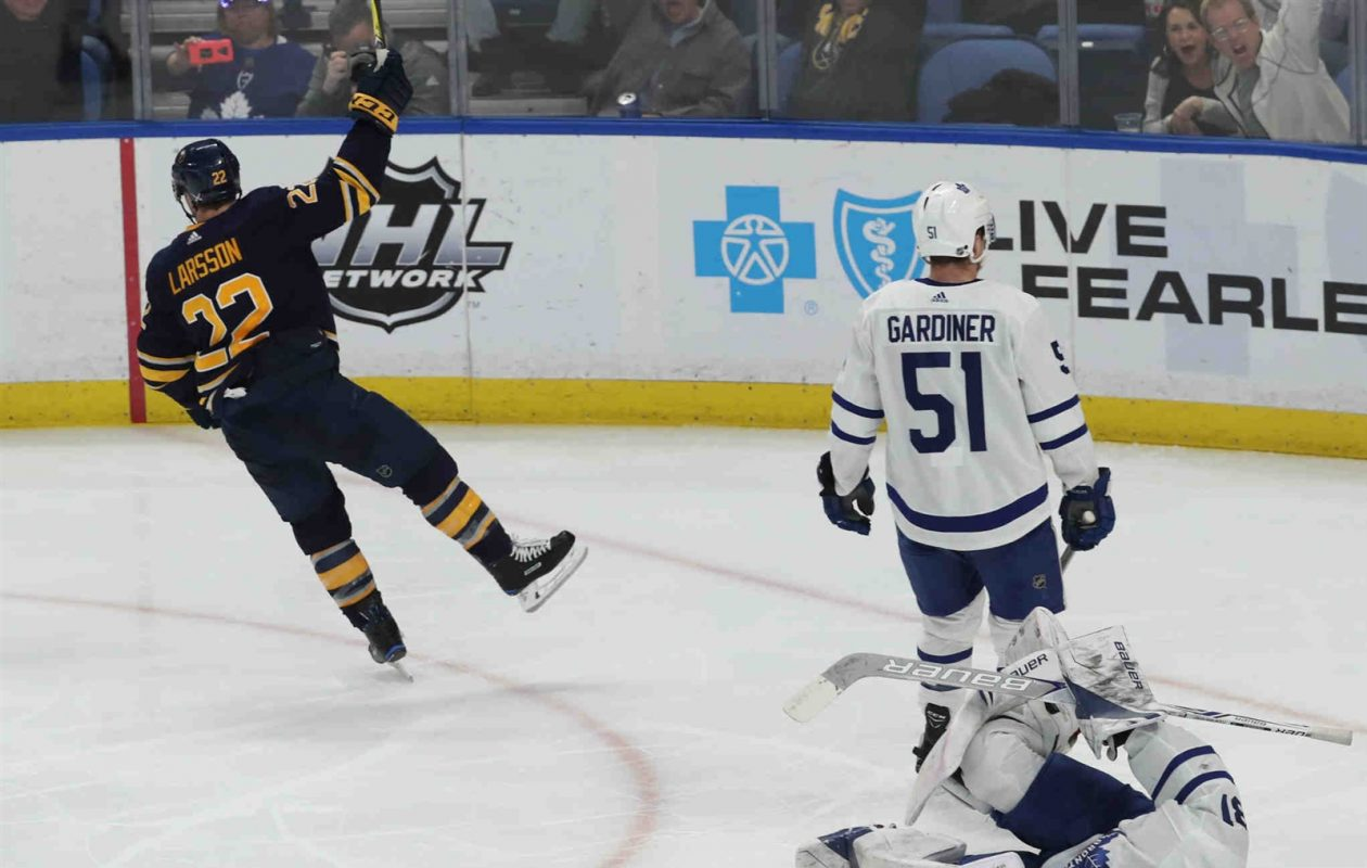 Not surprisingly, Johan Larsson got to celebrate a goal Monday during a March game against Toronto's Frederik Andersen and Jake Gardiner. (James P. McCoy/Buffalo News)