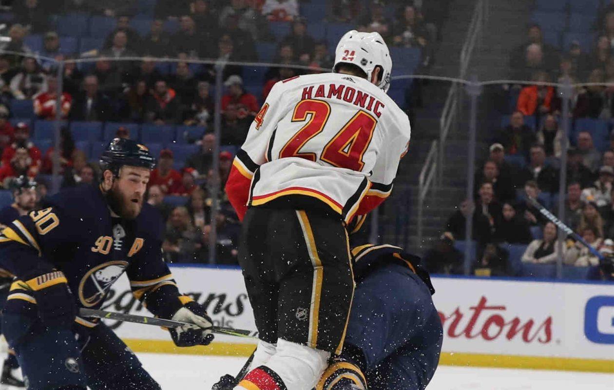 Travis Hamonic and Calgary ran over Seth Griffith and the Sabres. (James P. McCoy/Buffalo News)