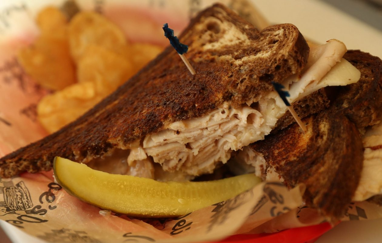 A favorite at Joe's Deli, the Rachel Ann is sliced turkey breast, Lorraine Swiss, sauerkraut or coleslaw  with housemade Russian dressing on marble rye. (Sharon Cantillon/Buffalo News)