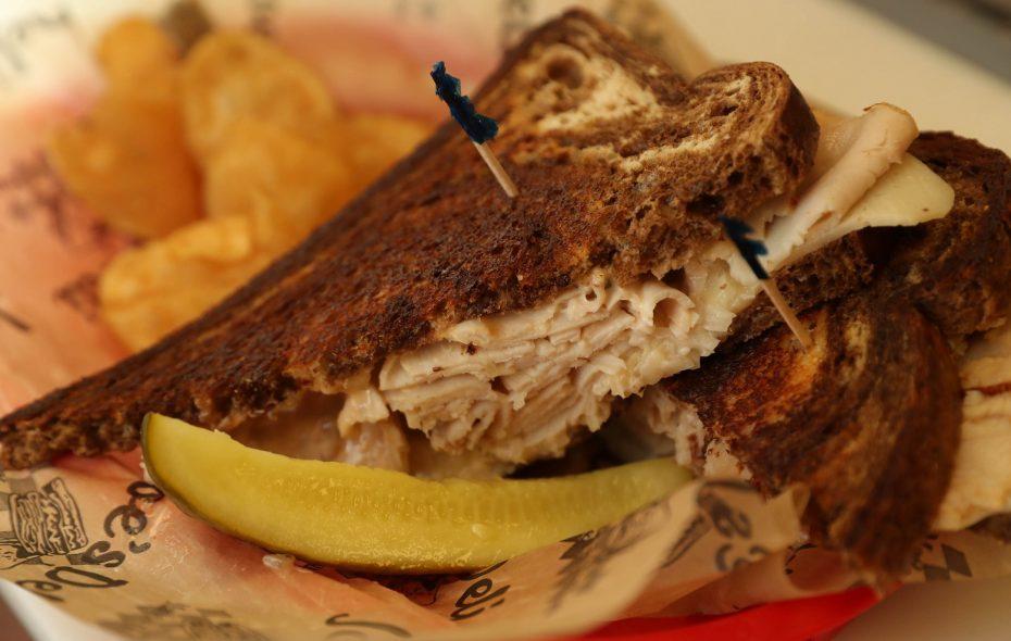 A favorite at Joe's Deli, the Rachel Ann is sliced turkey breast, Lorraine Swiss, sauerkraut or coleslaw  with housemade Russian dressing on marble rye. (Sharon Cantillon/Buffalo News)