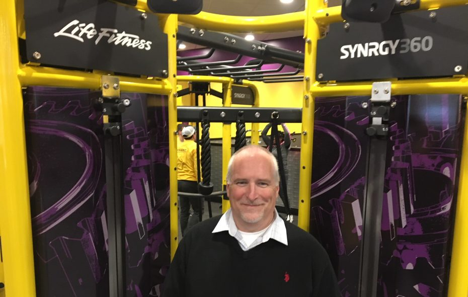 "ECP-PF Holdings, which now runs four Planet Fitness locations in Erie County, looks to open more across the region, says John Hrinda, the holding company's New York Division president. He is pictured Wednesday night in the Cheektowaga Club in front of the PF360 apparatus, which he described as  an ""adult jungle gym."" (Scott Scanlon/Buffalo News)"