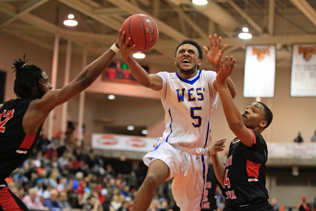 Juston Johnson attacks the basket en route to scoring a career-high 43 points during West Seneca West's 81-79 victory over South Park in the Section VI Class A final Tuesday night at Buffalo State. (Harry Scull Jr./Buffalo News)