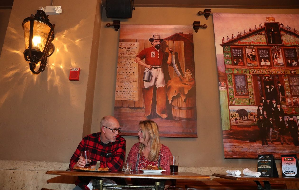 Chad and Darcie Lafever of Olcott have a bite to eat while watching the Winter Olympics. (Sharon Cantillon/Buffalo News)
