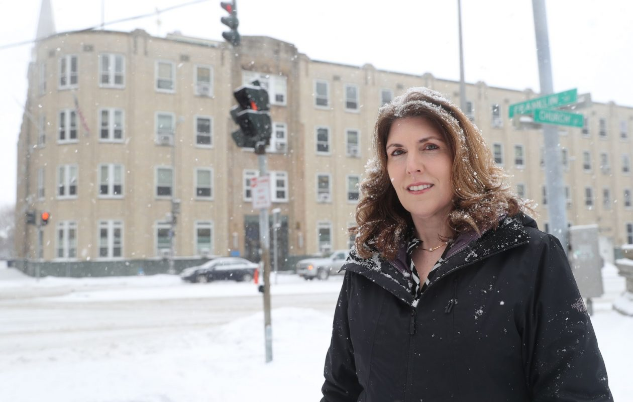 Lissa Marie Redmond is a retired Buffalo Police cold case detective and now an author. She's standing in front of Police Headquarters where she worked most of her 22 years on the force and where much of the story takes place. (Sharon Cantillon/Buffalo News)