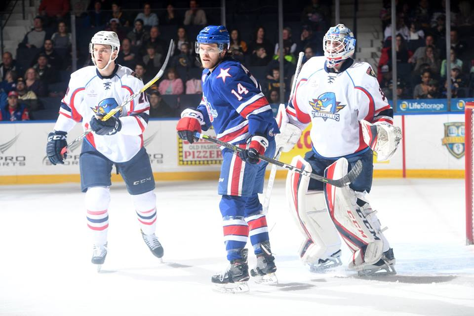 Buffalo native Sean Malone (14) gets position in front of the Springfield net Saturday night (Rochester Amerks photo)
