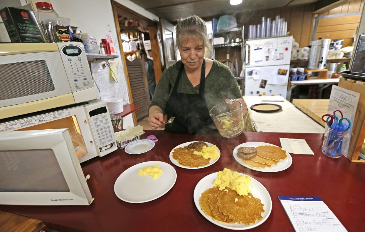 Owner Joan Moore tries to keep up with the orders at Moore's Maple Shack, 10444 Galen Hill Road in Freedom. (Robert Kirkham/Buffalo News)