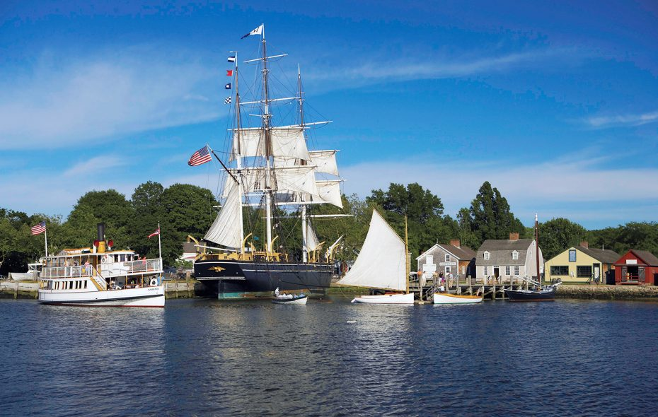 The watercraft collection at Mystic Seaport is the largest of its kind in the United States and includes four National Historic Landmark vessels: The whaleship Charles W. Morgan (center); the L.A. Dunton; steamboat Sabino (left); and the Emma C. Berry. (Mystic Seaport)