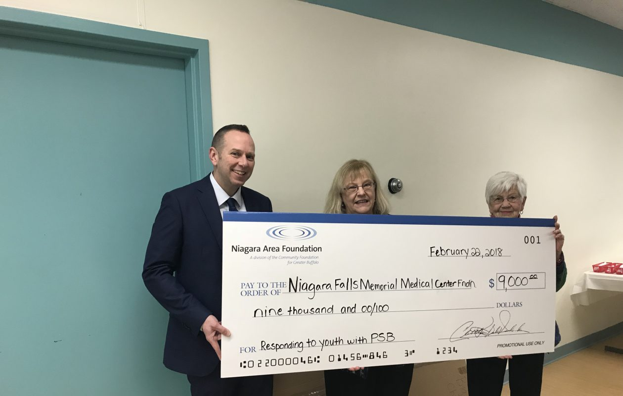 The Niagara Area Foundation presents a check to the Niagara Falls Memorial Medical Center Foundation. Pictured left to right: Bruce Elliott, Niagara Area Foundation chairman; Ann Marie Tucker, Child Advocacy Center of Niagara executive director; Betsy Diachun, Niagara Area Foundation board member. (Contributed photo)
