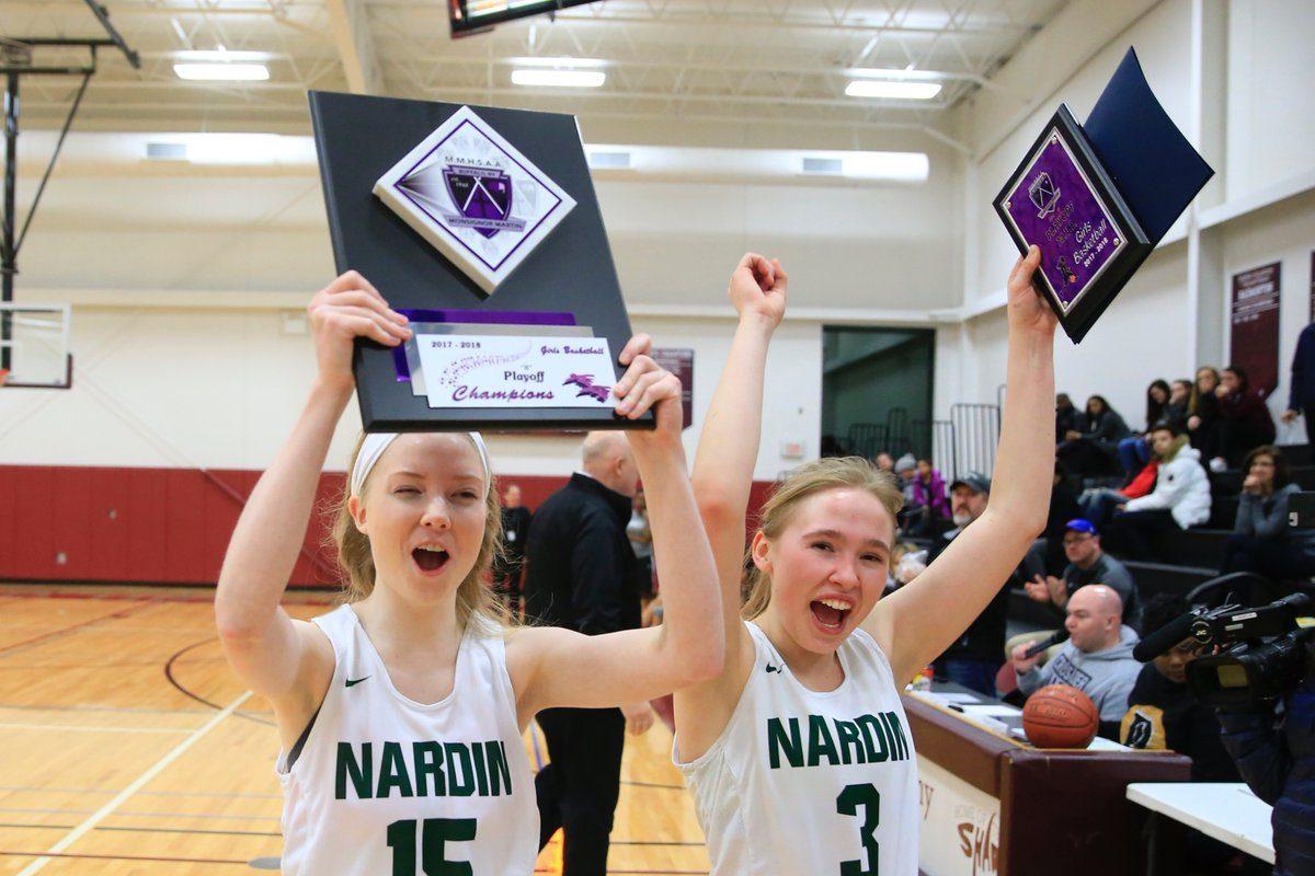 Nardin's Caroline Mahoney, left, and Lindsay Karas celebrate their Monsignor Martin Class B girls basketball title. (Harry Scull Jr./Buffalo News)