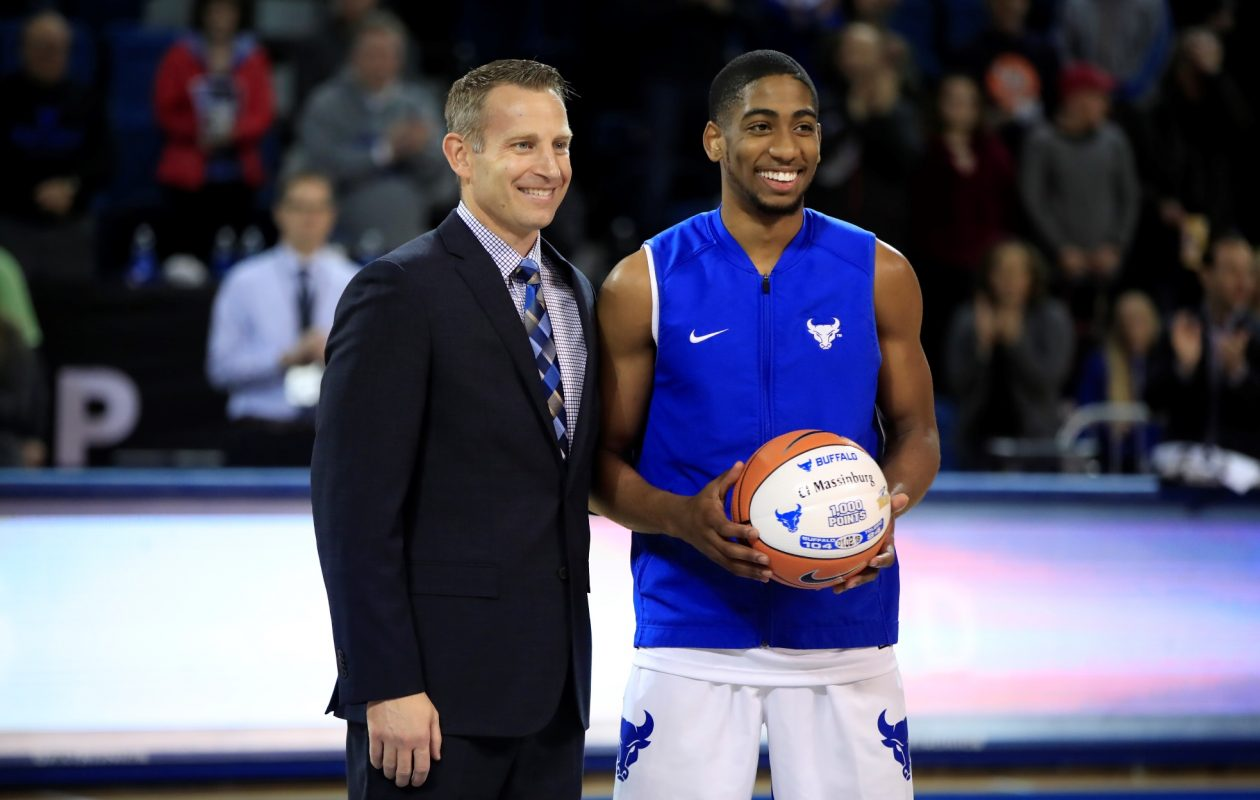 University at Buffalo head coach Nate Oats presents CJ Massinburg a ball commerating his 1,000th point prior to playing Miami at Alumni Arena on Jan. 13, 2018. (Harry Scull Jr./ Buffalo News)