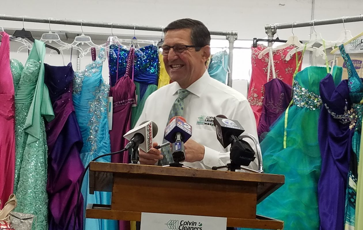 Colvin Cleaners Owner Paul Billoni kicks off the 2018 Gowns for Prom season at the Kenmore warehouse. (John Hickey/News file photo)