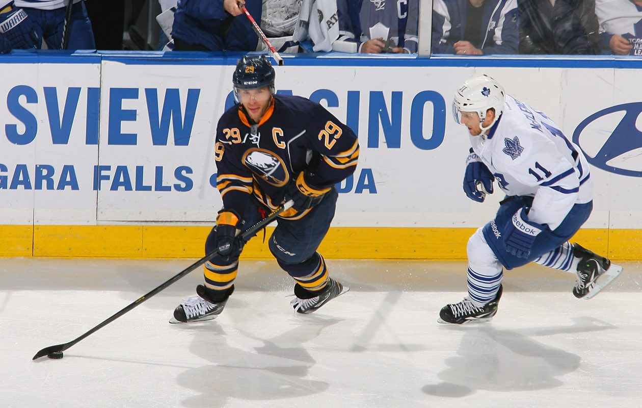 Jason Pominville works against Jay McClement of the Leafs during his last meeting against Toronto here on March 21, 2013. (Getty Images).