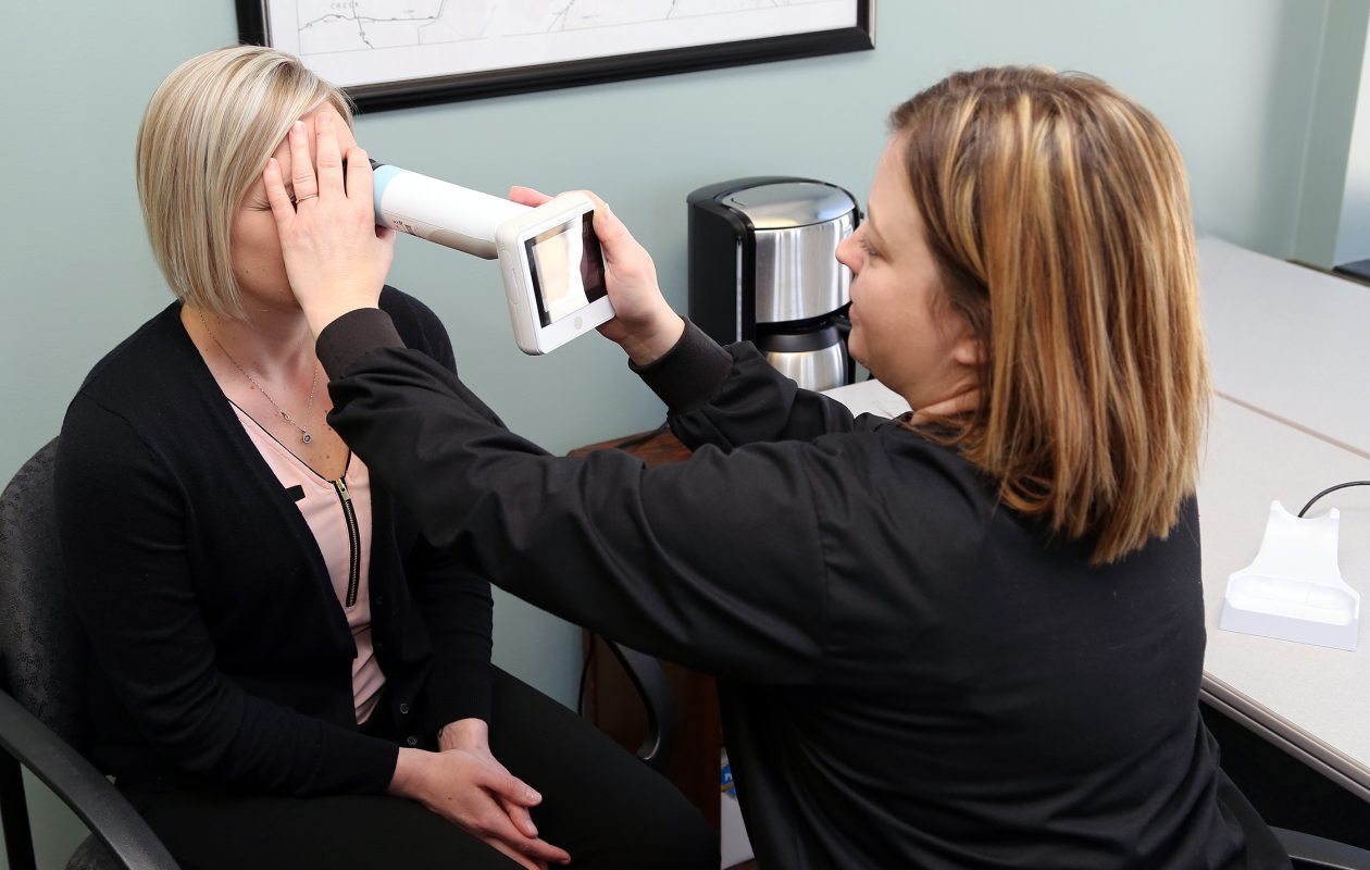 Natalie Sturges, left, receives a retinal exam from nurse Melissa Pugh from Family Health Medical Services in Mayville. (Univera Healthcare/Special to The News)