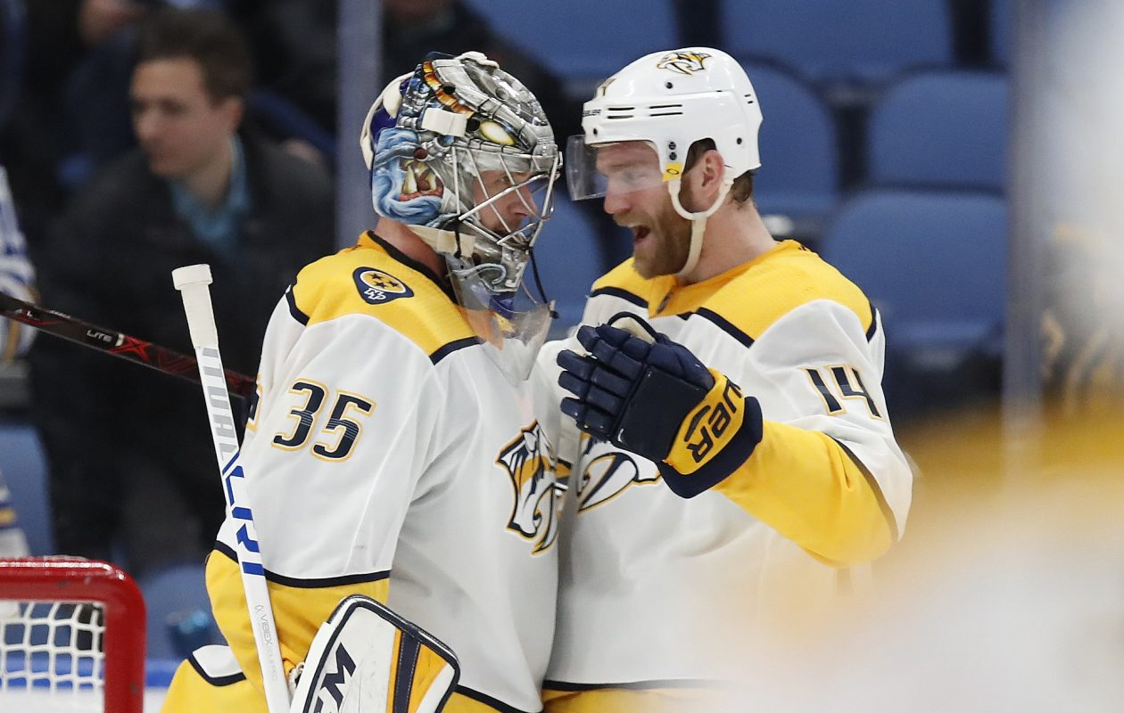 Predators defenseman Mattias Ekholm, right, gives it up to Pekka Rinne after the Nashville goalie posted his eighth shutout and 40th win of the season Monday night against the Sabres (Harry Scull Jr./Buffalo News).